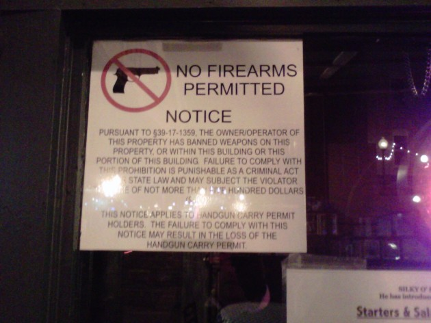 Sign on Beale Street bar, in case you're packing heat...