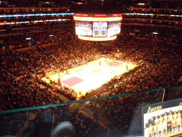 The only thing preventing a big splat from the third tier onto the hardwood of the Staples Center was that flimsly plexiglass barrier.