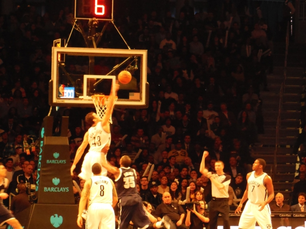 Kris Humphries is called for a crucial goal-tending infraction on this play. Looked good from where I was sitting.