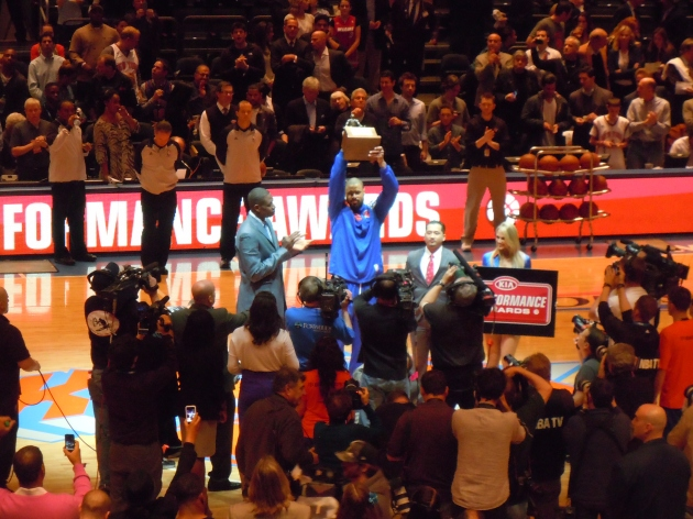 Tyson Chandler accepting his Defensive Player of the Year Award from Dikembe Mutombo