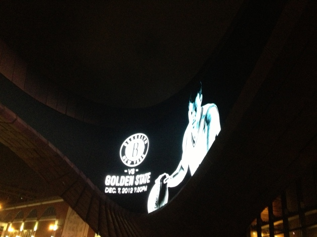 Kris Humphries is coming  achya. Funky digital banner outside the Barclays.
